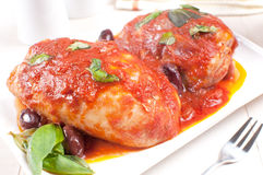 Chicken braised with basil, tomato sauce and olives Stock Images