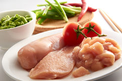 Chicken Breast. Meat and vegetable on clean setup Stock Photography
