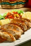 Chicken Breast. Grilled chicken breast with mango salsa and baked potatoes royalty free stock images
