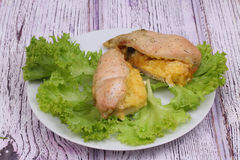 Chicken breast baked with cheese submitted on leaves of fresh salad Stock Photos