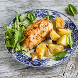 Chicken breast baked with potatoes on the blue plate Royalty Free Stock Images