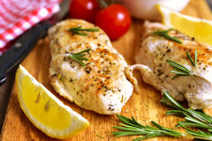 Chicken breast baked with rosemary. Stock Photos