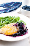 Chicken breast in blueberry sauce with cheese Stock Photography
