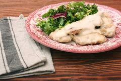 Chicken breast with cream sauce and green Royalty Free Stock Photography