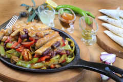 Chicken breast cuts fajitas and vegetables. Chicken breast fajitas with yogurt and vegetables and sause on wooden table Royalty Free Stock Photo