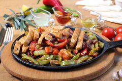 Chicken breast cuts fajitas and vegetables. Chicken breast fajitas with yogurt and vegetables and sause on wooden table Stock Images