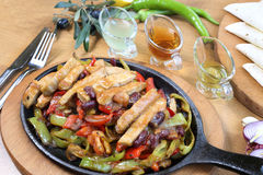 Chicken breast cuts fajitas and vegetables. Chicken breast fajitas with yogurt and vegetables and sause on wooden table Royalty Free Stock Photography
