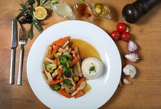 Chicken breast cuts with rice and vegetables. Aerial picture of Chicken breast cuts with rice and vegetables ans sause on wooden table Stock Photography