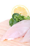 Chicken breast fillet. On wooden cutting board, closeup Royalty Free Stock Image
