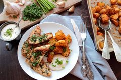 Chicken breast fillet with fried potatoes Stock Photography