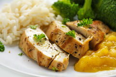 Chicken breast fillet with fruity mango chuntey, broccoli and ri Royalty Free Stock Photos