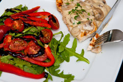 Chicken breast fillet with mushrooms. A tasty dinner dish of chicken breast fillet with mushrooms sauce, peppers, tomatoes and ruccola salad. Whole series with stock photography