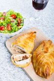Chicken breast in french pastry with fresh salad Stock Photo