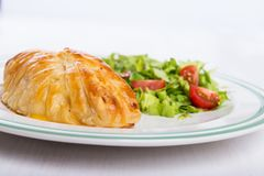 Chicken breast in french pastry with fresh salad royalty free stock image