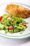 Chicken breast in french pastry with fresh salad royalty free stock photo