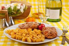 Chicken breast with fried potatoes and salad Stock Image