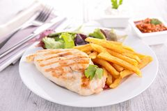 Chicken breast and fries Stock Photos