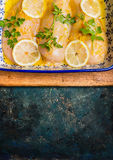 Chicken breast with lemon and seasoning on rustic background, top view Royalty Free Stock Images