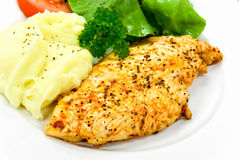 Chicken breast - marinated and baked,with salad Stock Photos