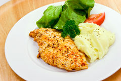 Chicken breast - marinated and baked,with salad royalty free stock photography