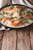 Chicken breast with mushrooms in cream sauce close-up. vertical Royalty Free Stock Photo