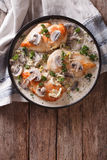 Chicken breast with mushrooms in cream sauce vertical top view. Chicken breast with mushrooms in cream sauce on a plate on the table. vertical top view royalty free stock image