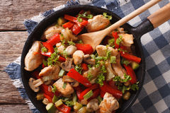 Chicken breast with mushrooms and vegetables on a pan close-up. Royalty Free Stock Photo