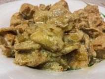 Chicken breast with mushrooms in white sauce Stock Images
