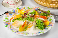 Chicken breast with nectarine and lettuce. Tasty dish: chicken breast with nectarine slices and lettuce on plate Stock Photography