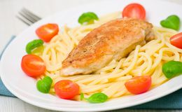 Chicken breast with pasta Stock Photo