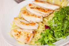 Chicken breast with pasta and salad Stock Photos