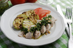 Chicken breast with Pesto sauce and vegetables Stock Image