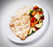 Chicken breast. Plate of chicken breast with rice and vegetables royalty free stock photography