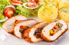 Chicken breast, potatoes and vegetables Stock Photos