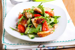Chicken breast, rocket, cucumber and tomato salad Stock Image