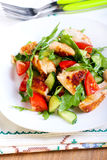 Chicken breast, rocket, cucumber and tomato salad Royalty Free Stock Photography