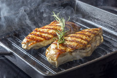 Chicken Breast with rosemary in pan Royalty Free Stock Photos