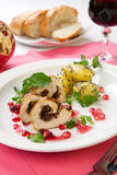 Chicken Breast Roulade. Dried cranberry and pesto stuffed chicken breast roulade with potato, watercress, and pomegranate sauce Royalty Free Stock Photo