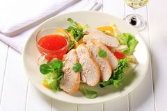 Chicken breast with salad and sweet chilli sauce Stock Image