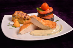Chicken breast schnitzel with vegetables (tomato, eggplant) and Stock Photo