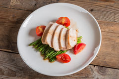 Chicken breast slice with asparagus and tomato. Top view. Royalty Free Stock Images