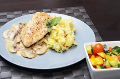 Chicken breast with smashed potatoes Stock Images