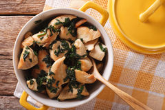 Chicken breast stewed with spinach in a saucepan. horizontal top Royalty Free Stock Images