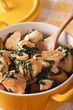 Chicken breast stewed with spinach in a saucepan macro. Vertical Royalty Free Stock Photos