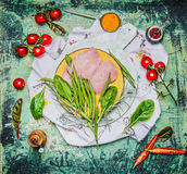 Chicken breast with string bean and ingredients for cooking on rustic wooden background, top view Stock Photography