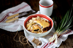 Chicken breast stuffed with mushrooms baked with potatoes under cheese. Stock Images