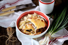 Chicken breast stuffed with mushrooms baked with potatoes under cheese. Royalty Free Stock Images