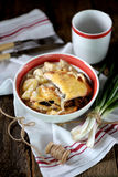 Chicken breast stuffed with mushrooms baked with potatoes under cheese. Royalty Free Stock Photos