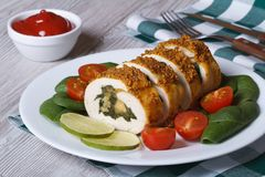 Chicken breast stuffed with spinach and cheese on a plate Royalty Free Stock Photo