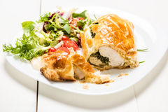 Chicken breast stuffed spinach in puff pastry Stock Photos